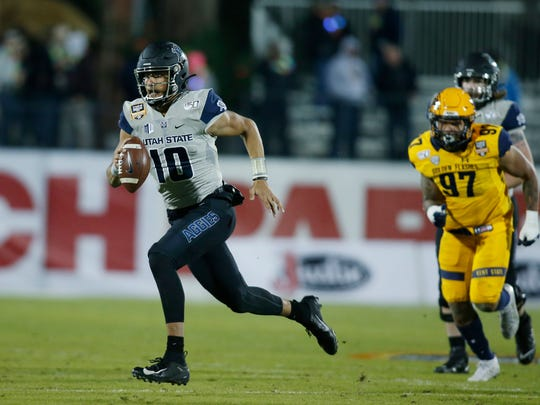 Dec 20, 2019; Frisco, TX, USA; Utah State Aggies quarterback Jordan Love (10) runs with the ball in the second quarter against the Kent State Golden Flashes during the Frisco Bowl at Toyota Stadium. Mandatory Credit: Tim Heitman-USA TODAY Sports