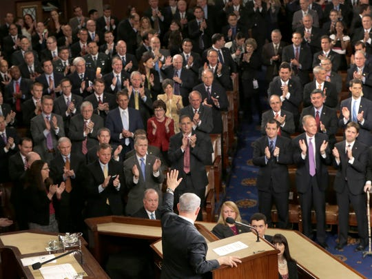 """Israeli Prime Minister Benjamin Netanyahu waves after speaking before a joint meeting of Congress on Capitol Hill in Washington, Tuesday, March 3, 2015. In a speech that stirred political intrigue in two countries, Netanyahu told Congress that negotiations underway between Iran and the U.S. would """"all but guarantee"""" that Tehran will get nuclear weapons, a step that the world must avoid at all costs. (AP Photo/J. Scott Applewhite)"""