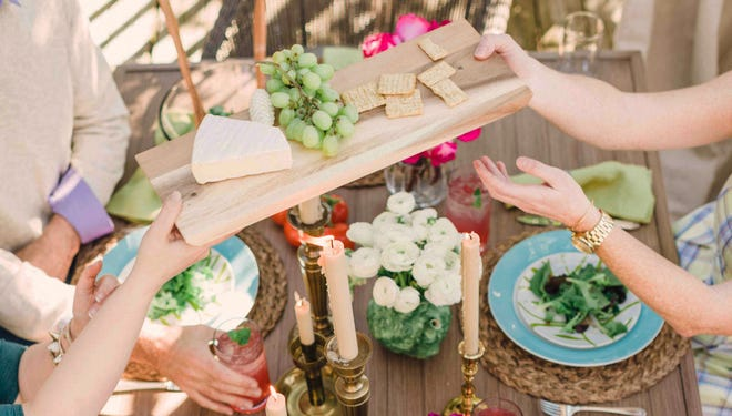 To keep gatherings easy going and enjoyable, the designer Flynn for HGTV.com Spring House suggests a casual outdoor table setting in which guests can help themselves and pass dishes and platters around the table family-style.