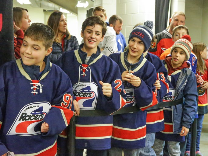 Members of the Indianapolis Racers wait for autographs