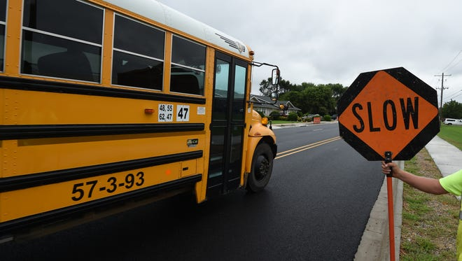 A Mountain Home school bus passes in front of Pinkston Middle School on Monday. Area officials remind local residents school begins Tuesday in Mountain and law enforcement officials will be watching to be certain motorists use caution as the new school year begins.