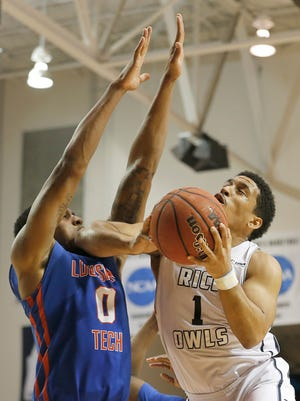 Rice guard Max Guercy (1) drives against Louisiana Tech guard Alex Hamilton (0) in the second half at Tudor Fieldhouse. Louisiana Tech won but has been inconsistent this year with defensive performances.