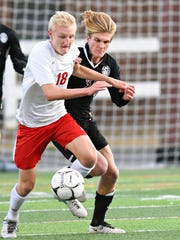 Susquehannock's Jason Weger, left, and Manheim Central's Gareth Kemp go after the ball during Round 2 of District 3, Class 3-A playoffs at Hersheypark Stadium in Hershey, Thursday, Oct. 26, 2017. Weger was honored as the Division II Player of the Year by the Y-A League coaches. Dawn J. Sagert photo