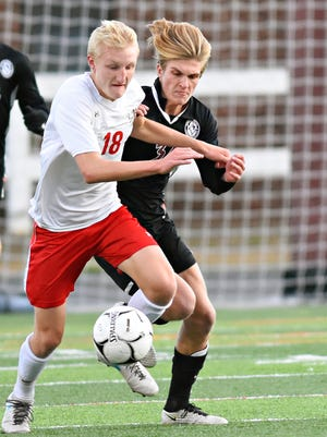 Susquehannock's Jason Weger, left, and Manheim Central's Gareth Kemp go after the ball during the District 3 Class 3-A playoffs at Hersheypark Stadium on Thursday, Oct. 26, 2017. Weger was one of three boys' soccer players from the Y-A League to earn all-state recognition for the 2017 season. Dawn J. Sagert photo