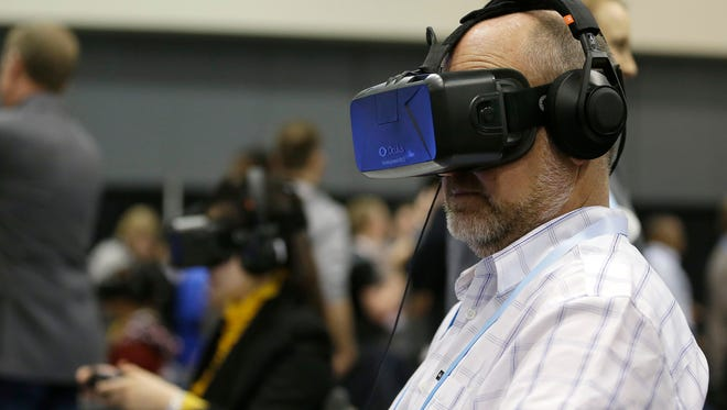 A man tries the Oculus virtual reality headset at the Game Developers Conference 2014 in San Francisco this month.