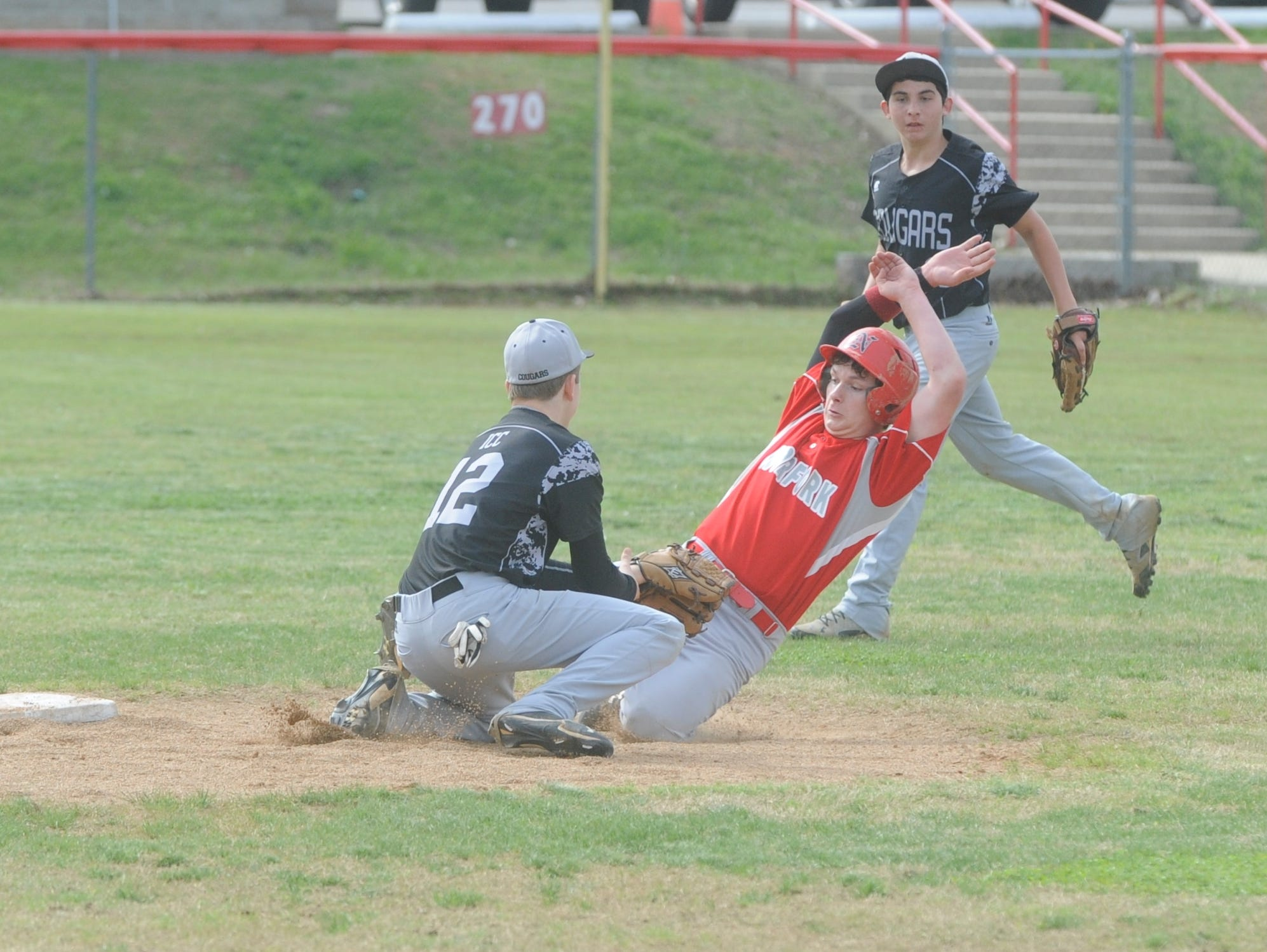 Norfork's Quinn Ellison is tagged out attempting to steal second base as Izard County's Cody Workman applies the tag during the Panthers' 17-2 win over the Cougars on Thursday.
