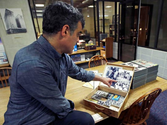 Pacey Foster, a rap historian and professor at UMass, reviews with a collection of hip-hop cassette tapes and memorabilia from the 1980's at the Boston campus of the University of Massachusetts in Boston, Thursday, Nov. 17, 2016. Thanks to UMass, the world will soon have access to 300 unreleased demo tapes from the early days of Boston hip-hop. The university paired with Boston Public Library to form a new hip-hop archive that's the latest example of colleges treating hip-hop as a scholarly subject.