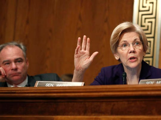 Sen. Elizabeth Warren, D-Mass., questions Education Secretary-designate Betsy DeVos on Capitol Hill in Washington, Tuesday, Jan. 17, 2017, at DeVos' confirmation hearing before the Senate Health, Education, Labor and Pensions Committee, as Sen. Tim Kaine, D-Va., listens.