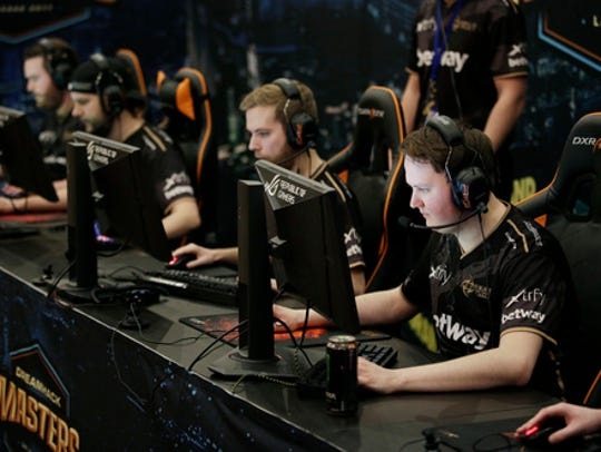 Ninjas in Pyjamas, a team from Sweden, competes during the Dreamhack Masters e-sports tournament at the MGM Grand Garden Arena in Las Vegas in 2017.