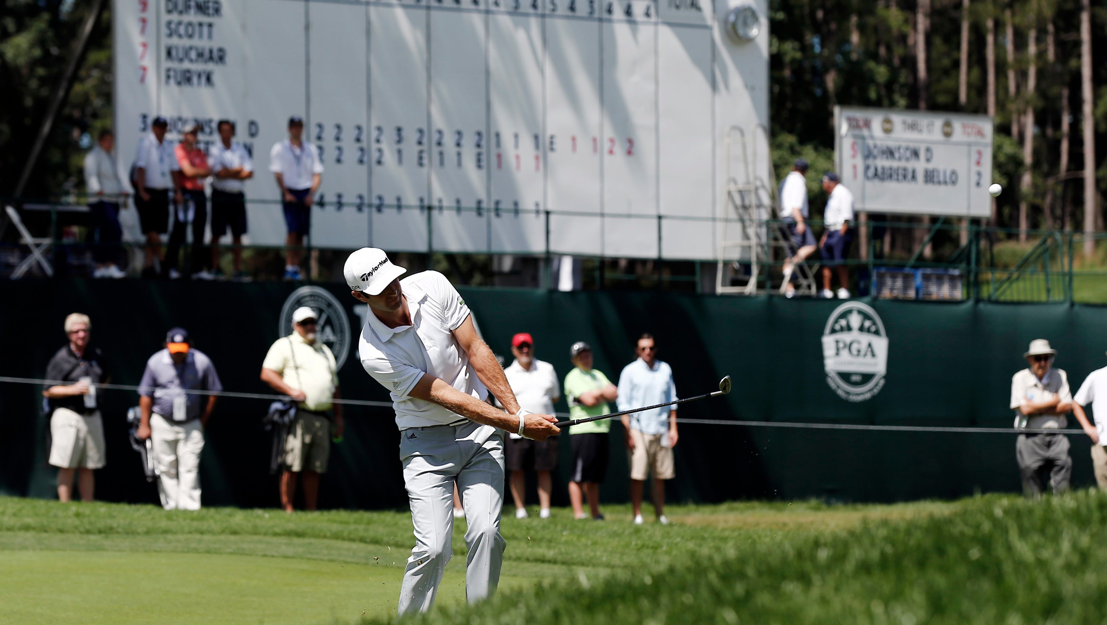 Dustin Johnson chips up to the 18th green on his way to a third-round 65.