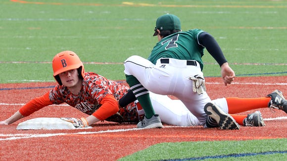 Pleasantville's Danny Melillo (7) misses the tag after Briarcliff's Jack Ryan (2) steals second base during baseball game at Briarcliff High School April 18, 2018.  Briarcliff defeats Pleasantville 15-2.