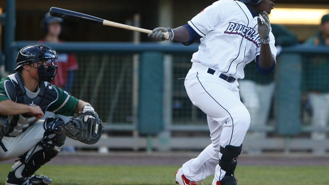 BlueClaws left fielder Cornelius Randolph hits an RBI single in the first inning of Thursday's home opener against the Greensboro Grasshoppers at FirstEnergy Park in Lakewood. Lakewood ended up losing, 7-4.