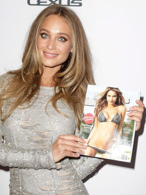 """The cover of the """"Sports Illustrated"""" swimsuit edition is Hannah Davis. Flip the magazine around to see what Snickers thinks a cover girl model might look like when she's hungry."""