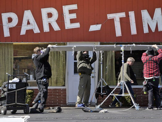 "Crew members for the film ""Carol"" set up a large silk in front of the old Spare Time Grill in Alexandria, Ky."