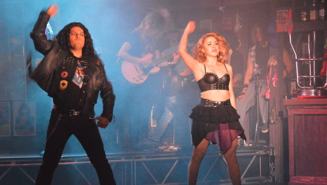 "Jonathan Contreras, left, and Nabil Gonzalez perform in the UTEP Dinner Theatre production of the Tony Award-nominated musical ""Rock of Ages."""