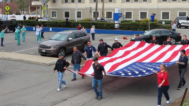 Emergency response crews carried a large American flag.