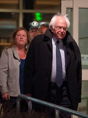 Sen. Bernie Sanders, I-Vt., emerges from a terminal at Burlington International Airport before addressing the media on Tuesday night shortly after his loss in the New York Democratic primary.