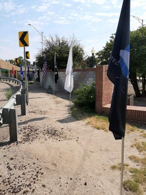 Flags posted along the central U.S. 50 curve that bends through Las Animas Monday in observation of Labor Day.