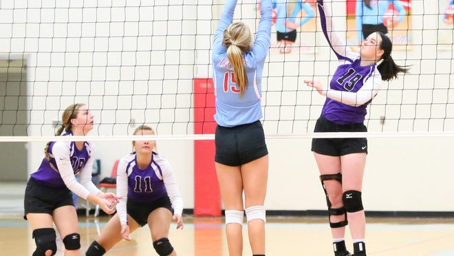 TCA's Savannah Woods (19) attempts to attack the ball as USJ's Camryn Coley tries to block on Monday at USJ.
