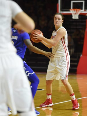 Marist College guard Allie Clement looks to make a pass on Tuesday against Seton Hall. Clement suffered a season-ending knee injury later in the game.
