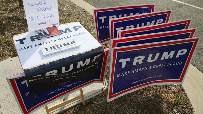 Trump signs are shown at Mechanicsville Elementary School polling station, April 26, 2016 in Mechanicsville, Maryland.