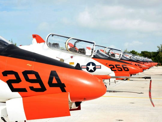 T-45 Goshawk jets sit at Naval Air Station Key West's Boca Chica Field in 2016. The Navy has grounded its entire fleet of T-45 trainer jets after instructor pilots raised concerns about the ability of aviators to breathe in them while flying, military officials said.