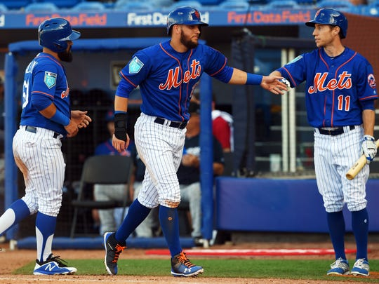 The Mets' Gavin Cecchini (middle) and Luis Guillorme