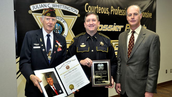 From left are Ken Koval, Bossier City VFW Post 5951 member, Lt. Bill Davis, Bossier Sheriff's Office Public Information Officer and Bossier Sheriff Julian Whittington
