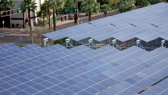 Regulators began to debate in 2008-09 whether the state energy standard appropriately split funding among solar on homes, businesses, and built in large power plants. Shown here is an Arizona State University project on the main campus.
