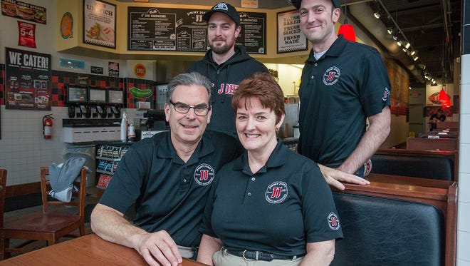 The Doelker family, sons Rich and Dan, and parents Jeff and Cheryl, brought the first Jimmy John's to Livonia. Now there are nine.