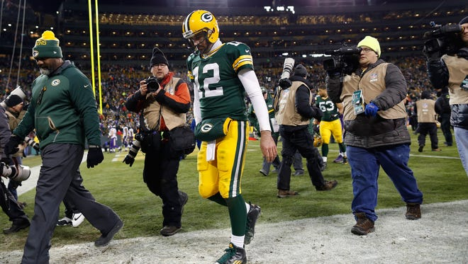 Green Bay Packers quarterback Aaron Rodgers (12) walks off the field following the Packers loss.