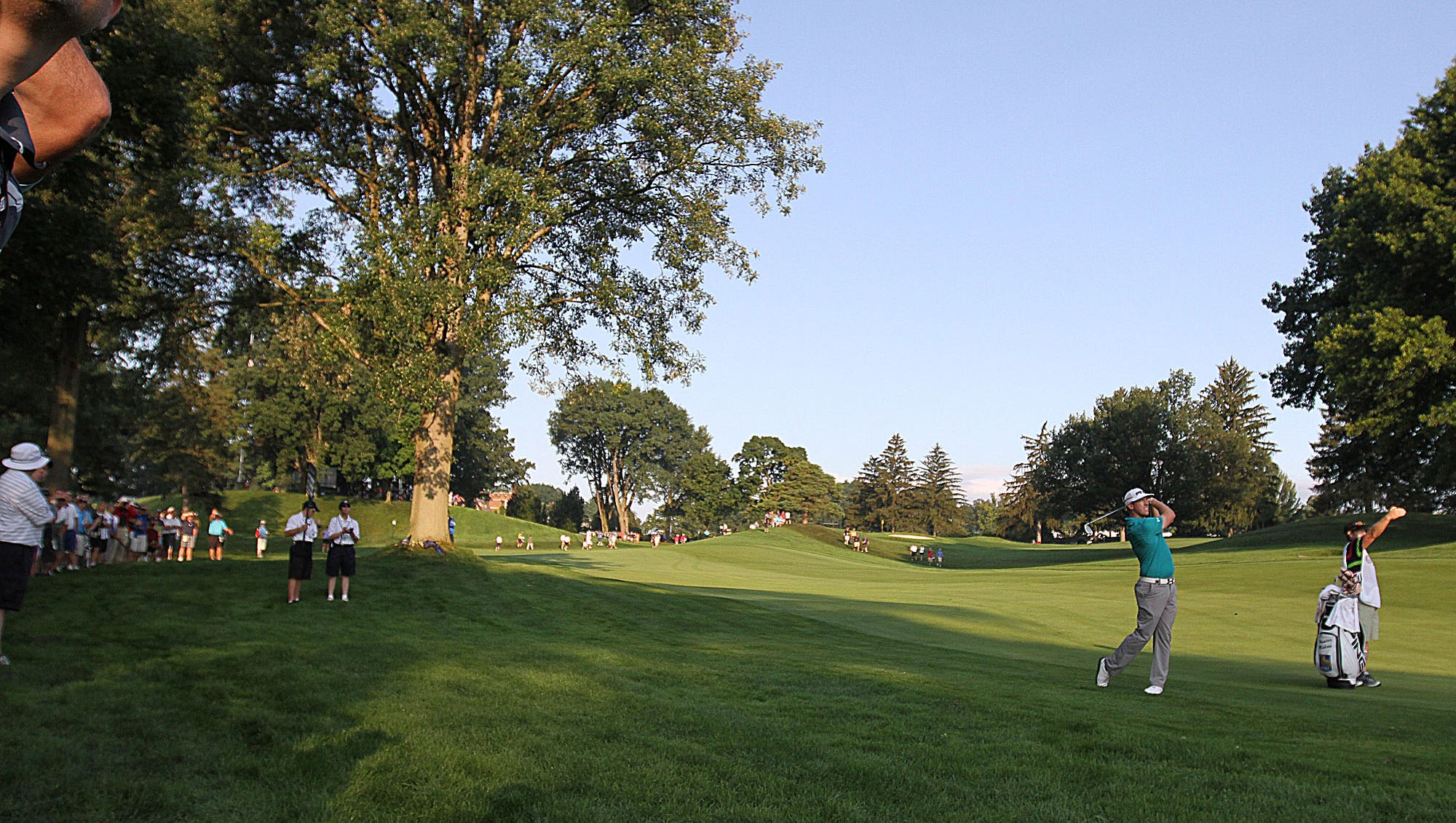 Hunter Mahan follows his shot on the fairway Thursday at Oak Hill.