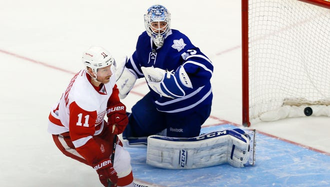Detroit Red Wings forward Daniel Alfredsson (11) scores on Toronto Maple Leafs goaltender Jonathan Bernier (45) during the shoot out at the Air Canada Centre. Detroit defeated Toronto 5-4 in an overtime shoot out.