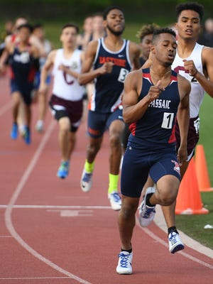 Luis Peralta (front), of Passaic High School, on his way to finishing first in the 800M on May 10, 2017.