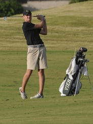 Viera's Calvin Sierota drives from the fairway.