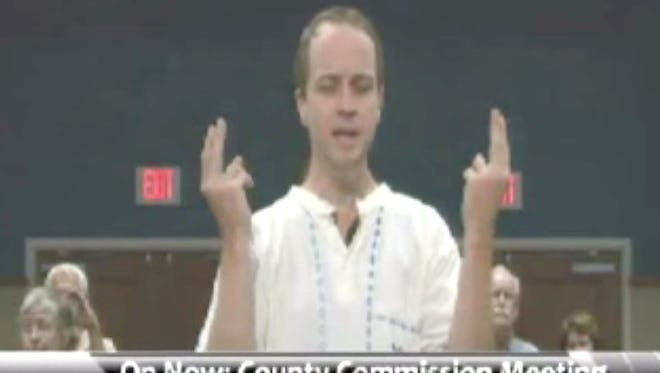 David Suhor, a self-described agnostic pagan pantheist, delivers a pagan prayer at a recent Escambia County Commission meeting.