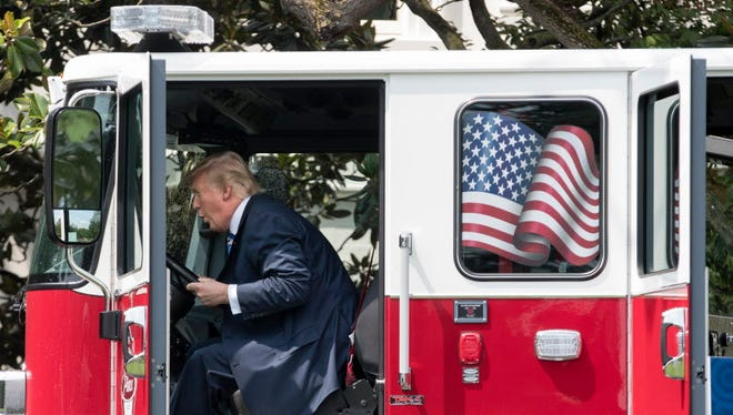 President Trump in a firetruck at the White House on July 17, 2017.