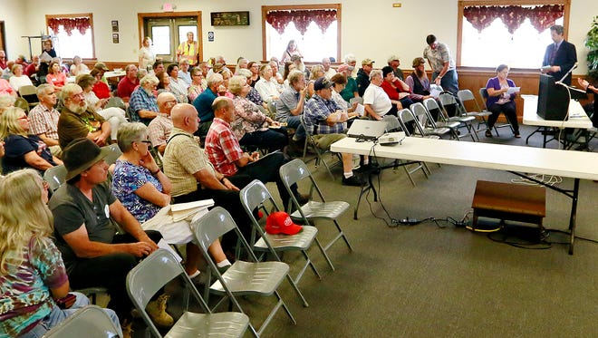 The York County Farm Bureau hosts York County farmers and landowners who live near the proposed Transource Independence high energy power line during a meeting at the Airville Volunteer Fire Company in Airville, Thursday, Aug. 24, 2017. Dawn J. Sagert photo