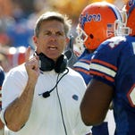 Former Florida Gators head coach Ron Zook, left, teams with Shawn Slocum to coach special teams for the NFL's Green Bay Packers.