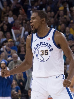 Golden State Warriors forward Kevin Durant (35) celebrates against the Washington Wizards during the fourth quarter at Oracle Arena.