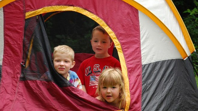 5-year-old Jackson Township triplets Nathan, Dylan, and Lily Robinson prepare for the Clermont County Park District Family Campout on Sept. 30, 2011.