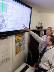 Transportation Director Ronnie Youngblood points out bus routes and how they are monitored.