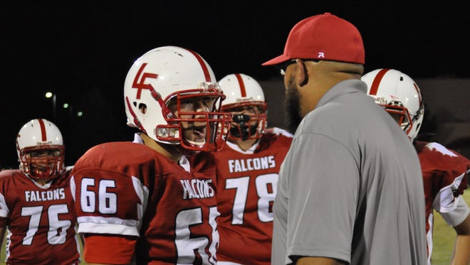 Junior offensive lineman Josiah Leija takes coaching from a coach Sept. 17. The Loving Falcons fell 48-12 to the Jal Panthers.
