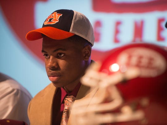 Daniel Thomas sits after signing with Auburn over Minnesota