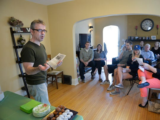 Southside University Neighborhood Association Co-President Rich Kelly addresses members during an association meeting April 16, 2016, at Co-President Kristen Berreau's St. Cloud home.