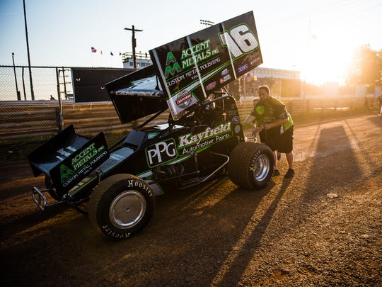 Pit crews guide cars on Friday after time trials at Williams Grove Speedway.