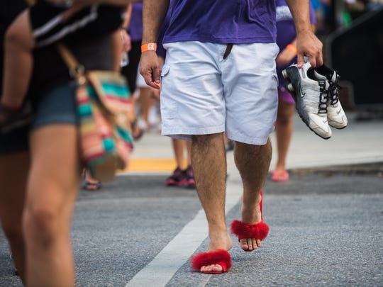Men sport high heels Friday Aug. 12, 2016 during Hanover's Walk a Mile in Her Shoes event. The event helps support Hanover YWCA's Safe Home program and Still Waters.