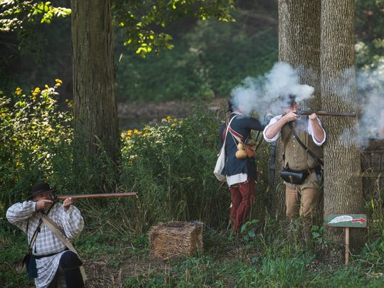 British re-enactors fire muskets Saturday Aug. 20, 2016 during a battle re-enactment at Mason and Dixon Day at the Mary Penn Bed and Breakfast near Gettysburg.