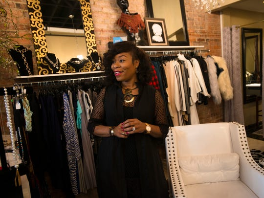 Iyishia Jones, owner of Ishi?, stands in her store after a press conference on Thursday, Nov. 17, 2016, outside of Ishi? in downtown Montgomery, Ala.