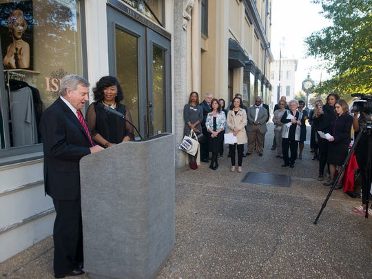 Mayor Todd Strange speaks as owner of Ishi?, Iyishia Jones, stands next to him during a press conference on Thursday, Nov. 17, 2016, outside of Ishi? in downtown Montgomery, Ala.